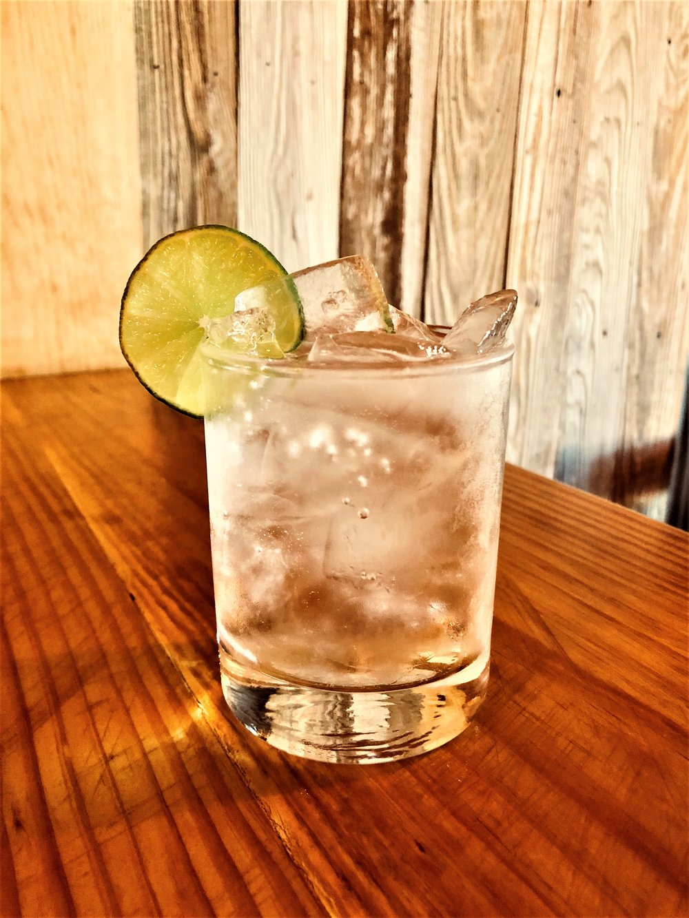WRV CLUB  - On ice, add 1 or 2 shots of WILD RAG VODKA or WILD RAG MESQUITE BEAN VODKA, fill with Club Soda.  Add a twist of lime.  Garnish with key lime slice.