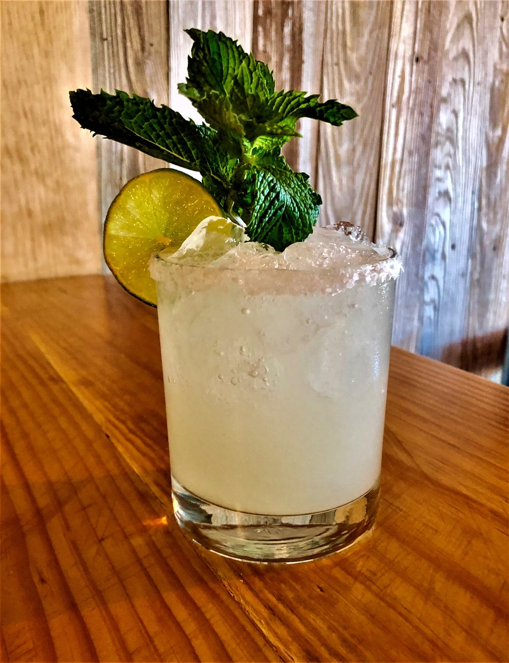 The Last One  - Salt the rim & fill glass with ice. In a shaker add 1 or 2 shots of WILD RAG VODKA or WILD RAG MESQUITE BEAN VODKA, 1.5 fresh squeezed key lime juice, 1 oz Simple Syrup, 1 oz Triple Sec, & 2 oz water - shake well and pour into glass. Garnish with key lime slice or wedge & mint leaf.