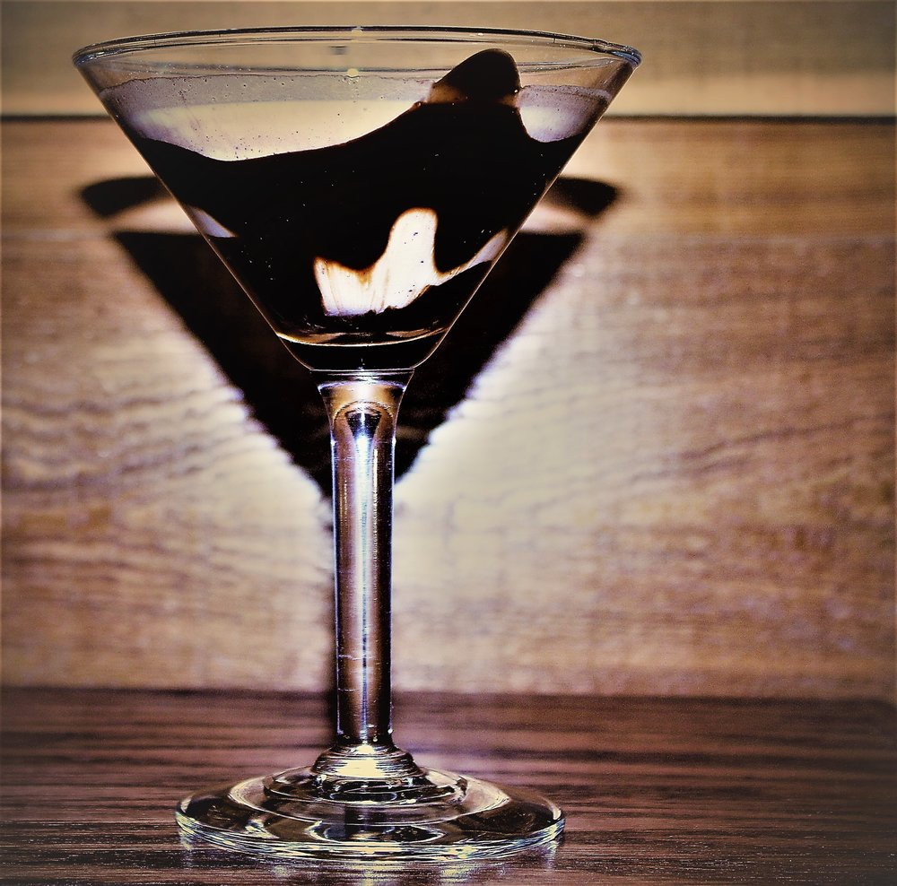 Choco Martini  - This rich but savory Martini is scrumptious. Drizzle Chocolate syrup inside glass, pour 1.5 shot Bailey's Cream & 1 shot of TEXAS TORCH Cinnamon Flavored Vodka. Sip slow for best results.