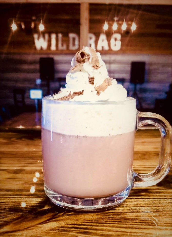 Coco Torch - Prepare your favorite cup of Hot Coco. Add a shot of Wild Rag TEXAS TORCH Cinnamon Flavored Vodka. Top with Whipped Cream. Sprinkle chocolate curl garnish. Savor this flavor. -