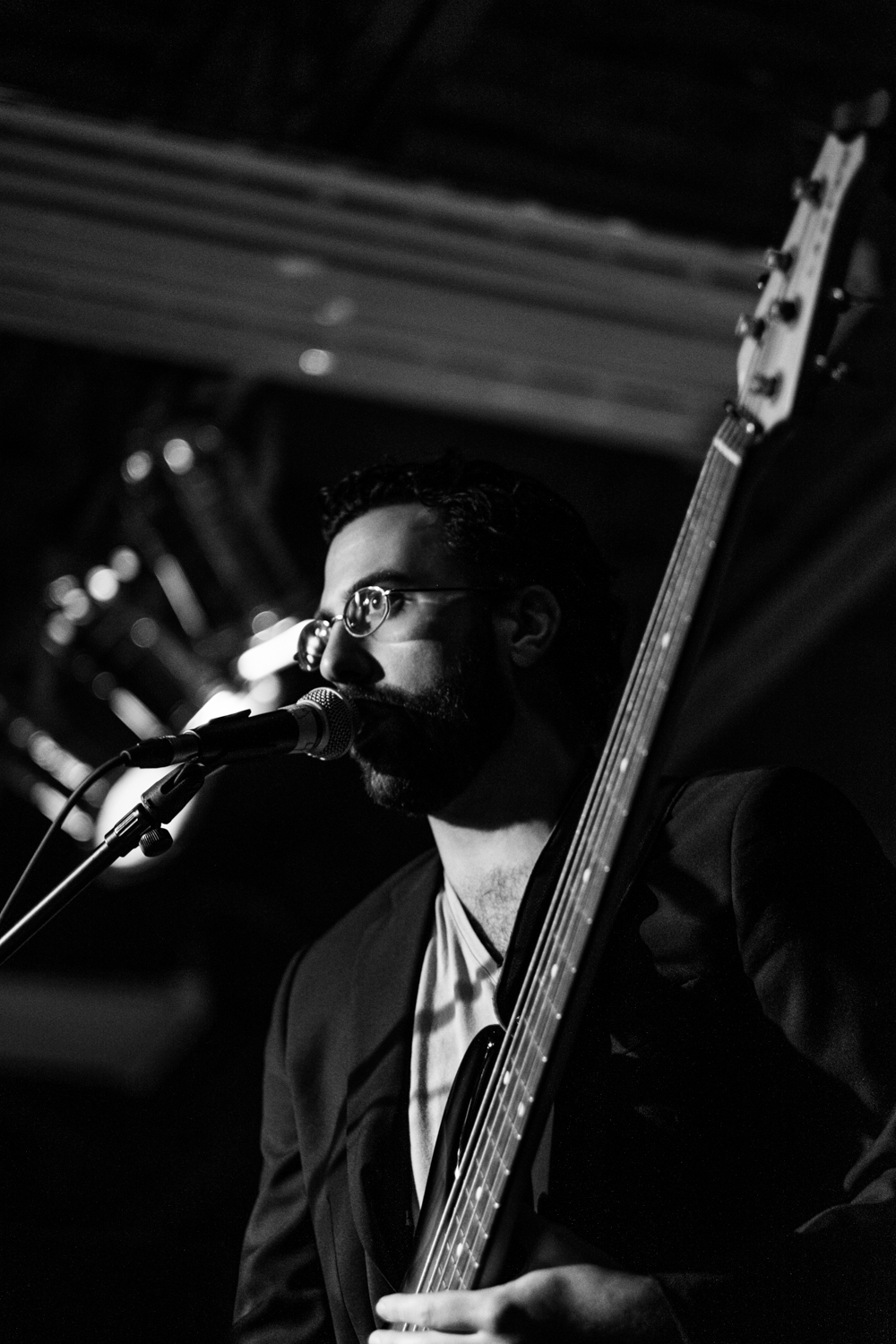 "Tony Schreiner - Bass, Talkbox   ""If it's not funky, take it to the curb and squish it."" Tony's life motto was honed growing up on the Southside of Minneapolis where a blend of hip hop, punk, R&B, afro-cuban, and pop blended into a unique score that would influence his life's work as a musician and recording engineer. 90s Tony learned these lessons they way we all might hope to learn anything: wearing acid-washed Jnco jeans and constantly calling things ""dope"". Well squish it Tony did, founding the successful afro-cuban project Malamanya who has performed all over the world. He applies that sense of rhythm and style to You Oughta Know, making Mmmbop that much more MMM-y."