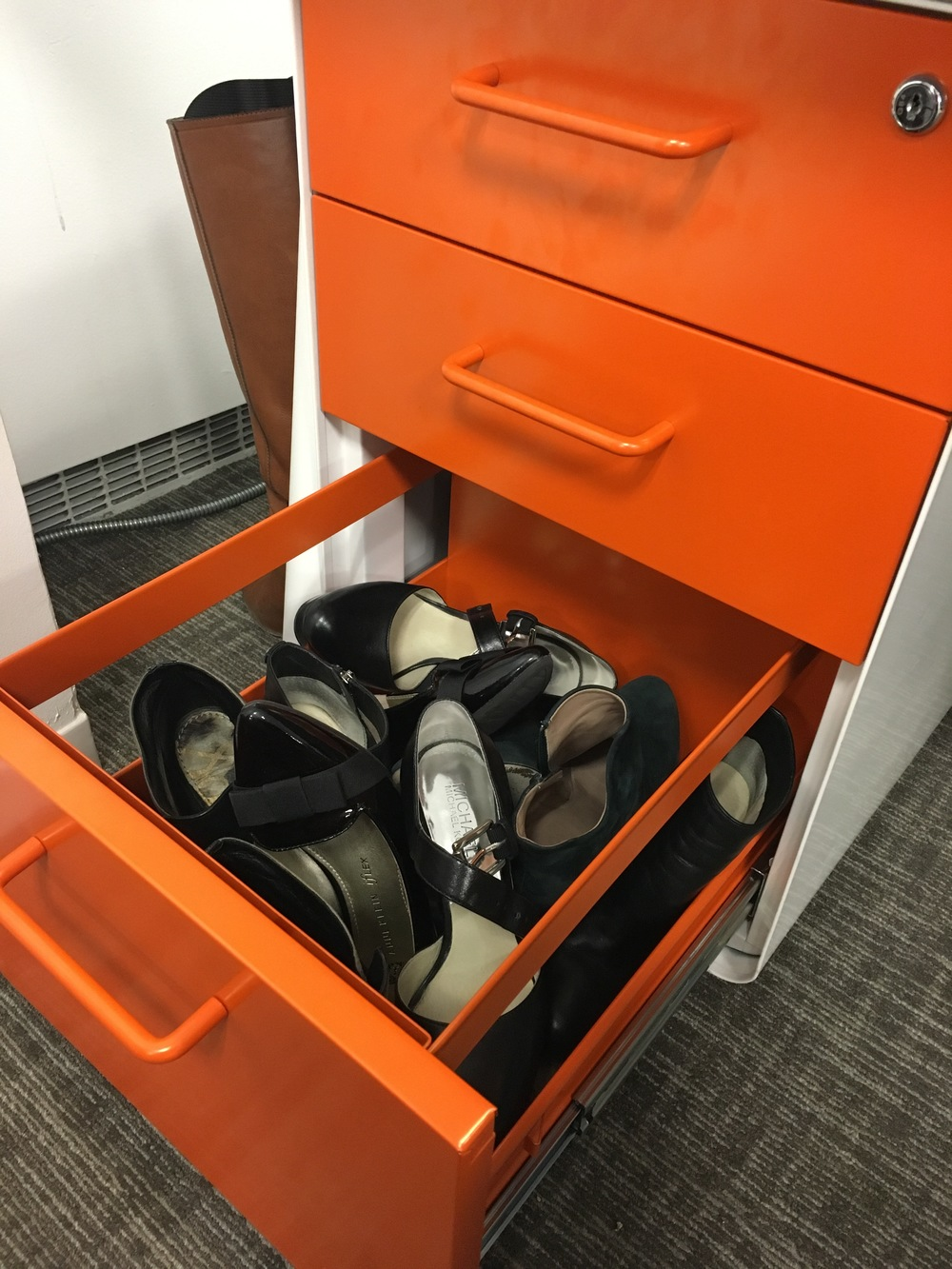 This is my bottom desk drawer at the uptown office. I wasn't lying about stowing away heels! Notice, boots poking around the corner.