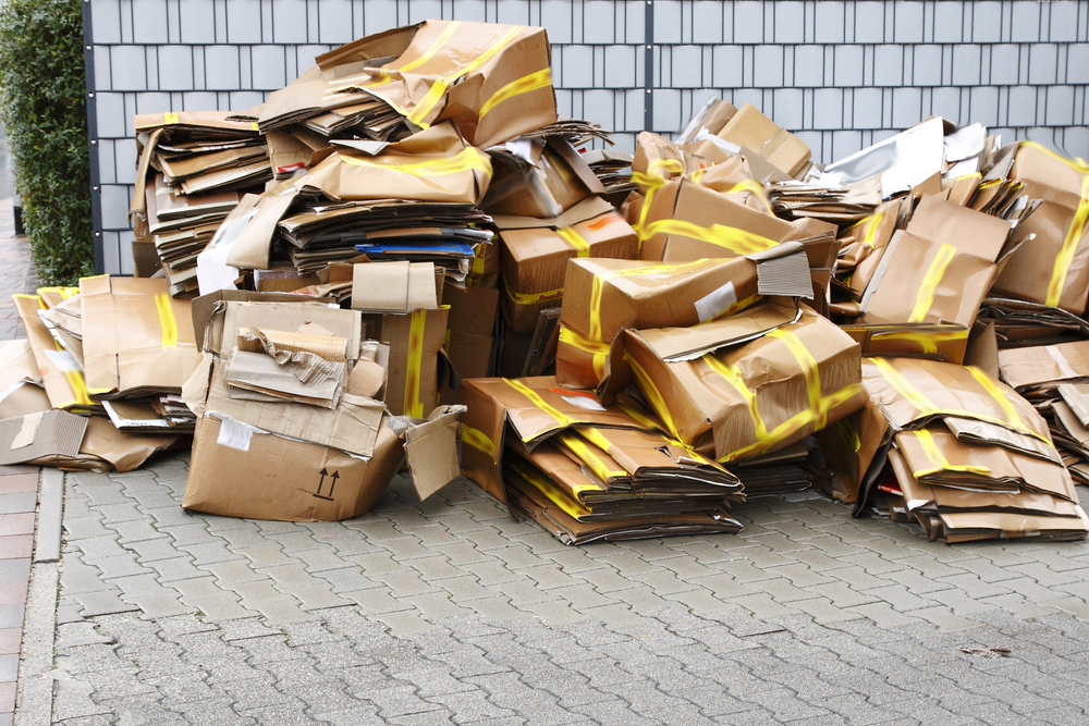 A pile of destroyed cardboard moving boxes