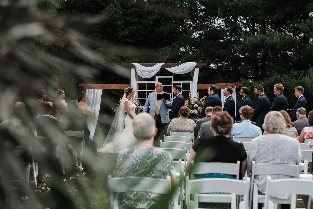 "the venue - ""We knew, even before we were engaged, we'd want to get married at Justin's parents' house, given the openness, and knew it would be a wonderful memory to hold for us and for our family."""