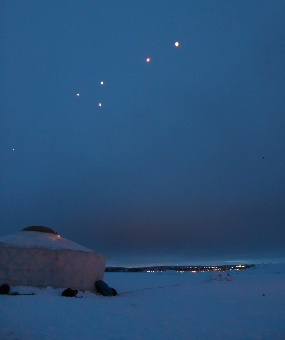 A magical moment, as the lanterns drift towards the town. Photo by Sara.