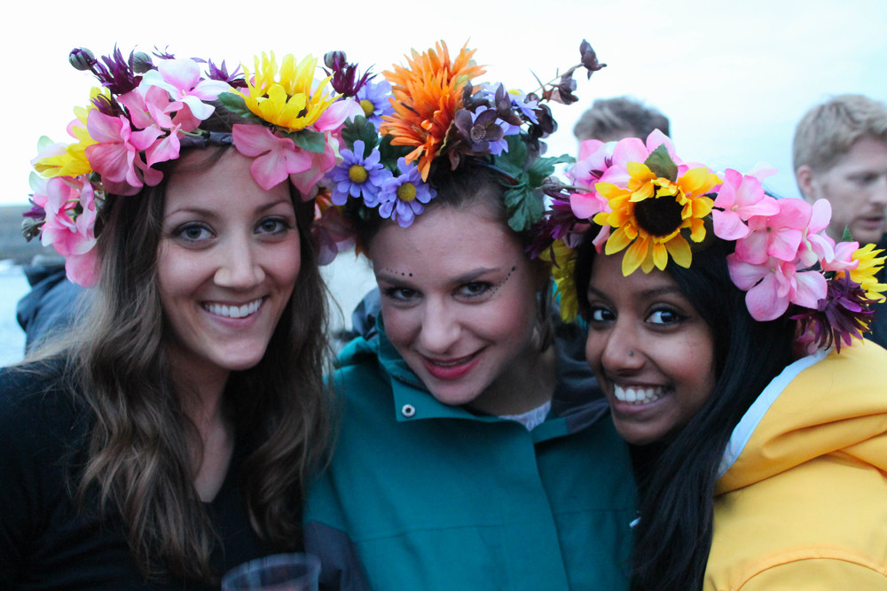 Sara, Katrina, and Anubha in homemade flower crowns. Full disclosure: We used fake flowers.