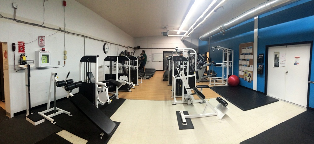 More weight equipment and cardio machines in Atii Fitness Centre's space.