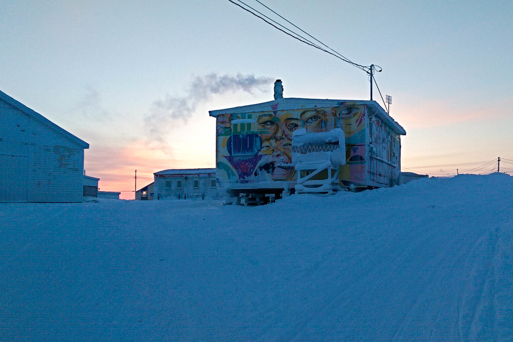 Colourful graffiti on the Igloolik Radio Station at sunrise. Photo by Denis Thibeault.