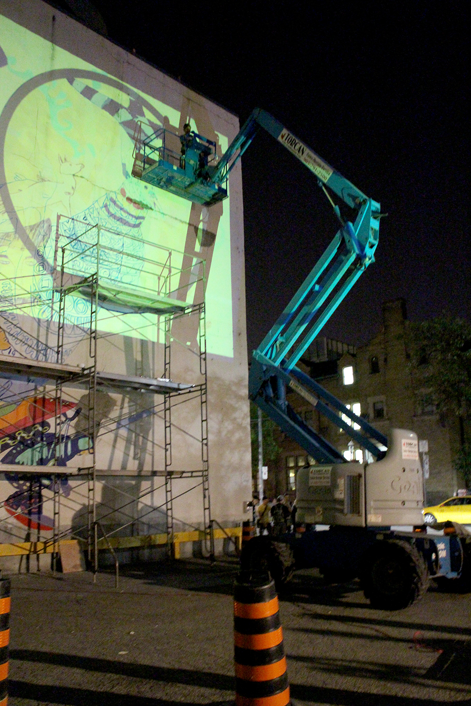 The mural was projected on the wall at night so that the artists could see and trace the outlines. Photo by Alexa Hatanaka.