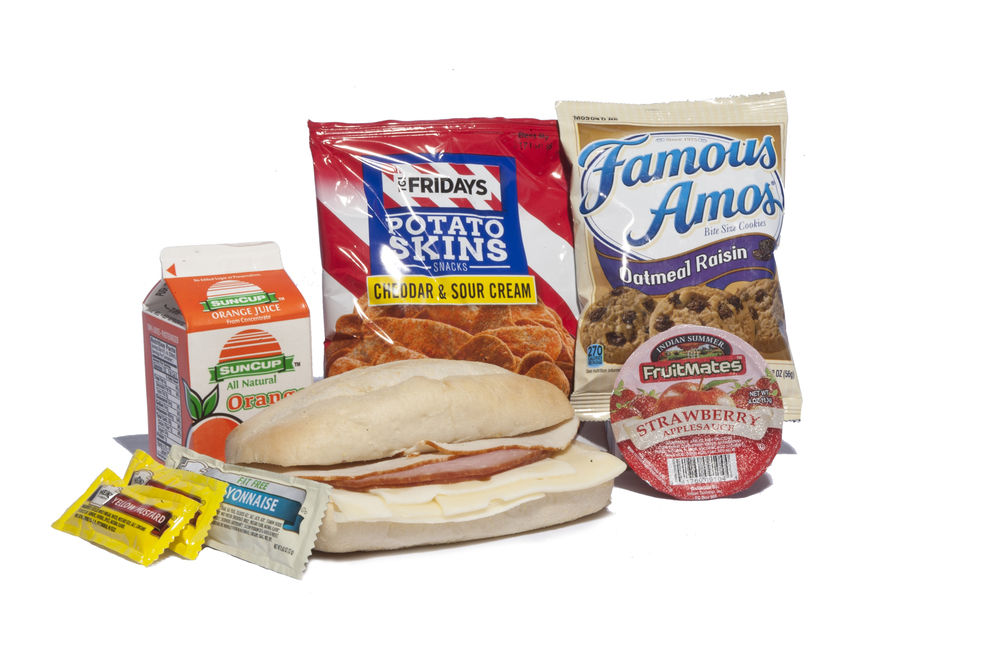 FK04 - Lunch / Dinner Turkey, Ham & Swiss on     Sub Bun Potato Skins Sour Cream & Cheddar Applesauce Strawberry Oatmeal Raisin Cookie Juice Orange Mayonnaise Packet 1 per Mustard Packet 2 per Cutlery Kit/Towelette NAPA # 8940-01-E60-8180