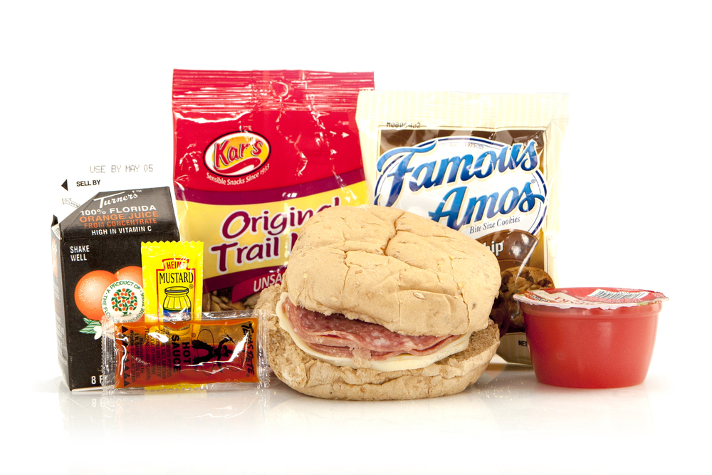 MK05 - LUNCH / DINNER  Salami & Provolone on Multi-Grain Bun Trail Mix - Original Chocolate Chip Cookies Strawberry Apple Sauce Hot Sauce Packet Mustard Packet Juice Orange 8oz Cutlery Kit Moist Towelette