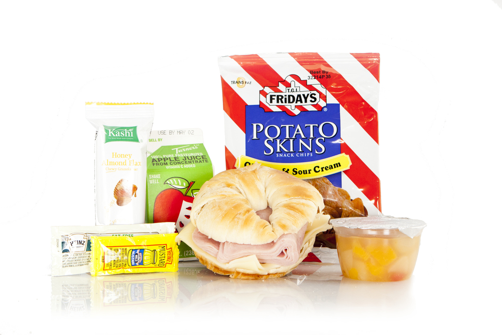 MK06 - LUNCH / DINNER  Ham & Swiss on Croissant Potato Skins Sour Cream & Cheddar Mixed Fruit Cup Honey Flax Kashi Bar Mayo Packet - Fat Free Mustard Packet Juice Apple 8oz Cutlery Kit Moist Towelette