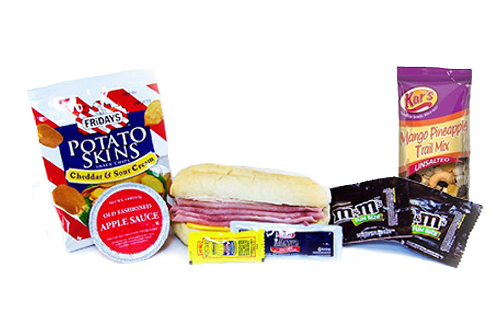MK04D - LUNCH / DINNER  Turkey, Ham and Cheddar on Sub Bun Potato Skins - Sour Cream & Cheddar Applesauce Cup M&M's - Plain - 2 per Mango/Pineapple Trail Mix Mayo Packet - 2 per Mustard Packet - 1 per Cutlery Kit/Moist Towelette