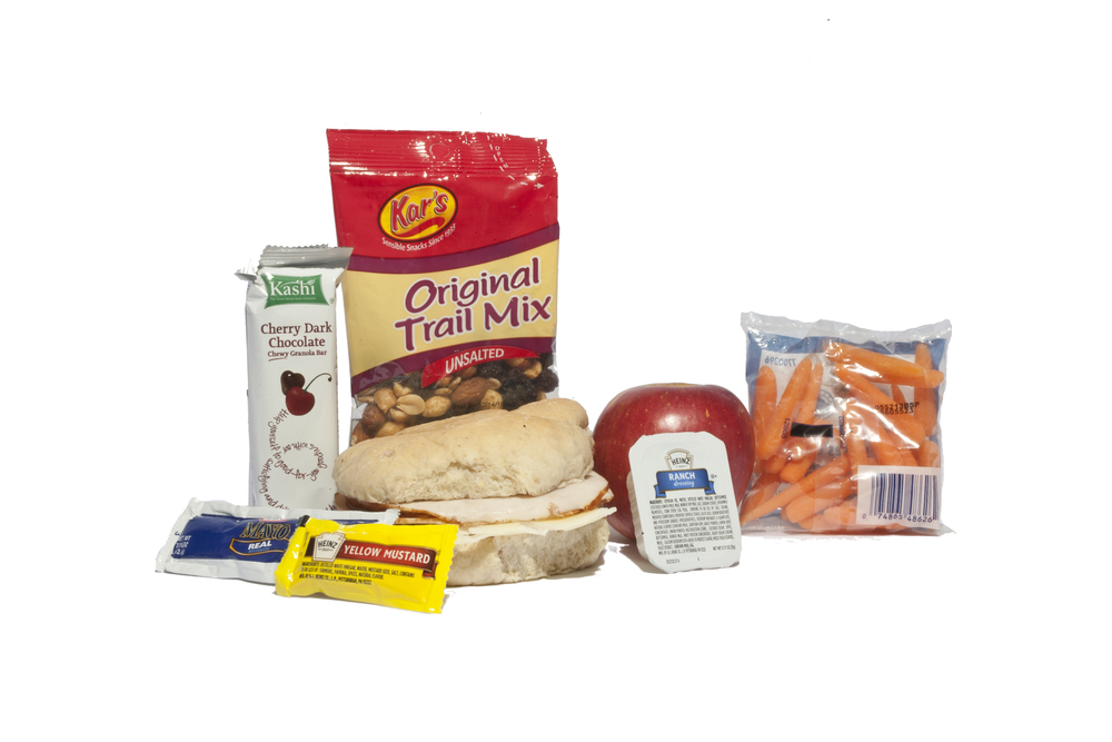 MK08D - LUNCH / DINNER Turkey & Swiss on Multi-Grain Bun Fresh Fuji Apple Cherry Dark Chocolate Kashi Bar Baby Carrots Ranch Dressing Cup Dorito Nacho Chip Mayo Packet - 2 per Mustard Packet - 1 per Cutlery Kit/Moist Towelette