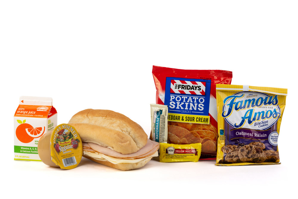 FK02 - Turkey/Swiss Sandwich - Frozen  NAPA 894001E608178  Sandwich - Turkey/ Swiss on Sub Bun Frozen  Chip Potato TGIF Cheddar Sour Cream  Applesauce Original Cookie Oatmeal Raisin Famous Amos  Frozen Orange Juice Mayonnaise Packet Fatfree Dressing  Mustard Packet Candy Mint Starlight Spearmint