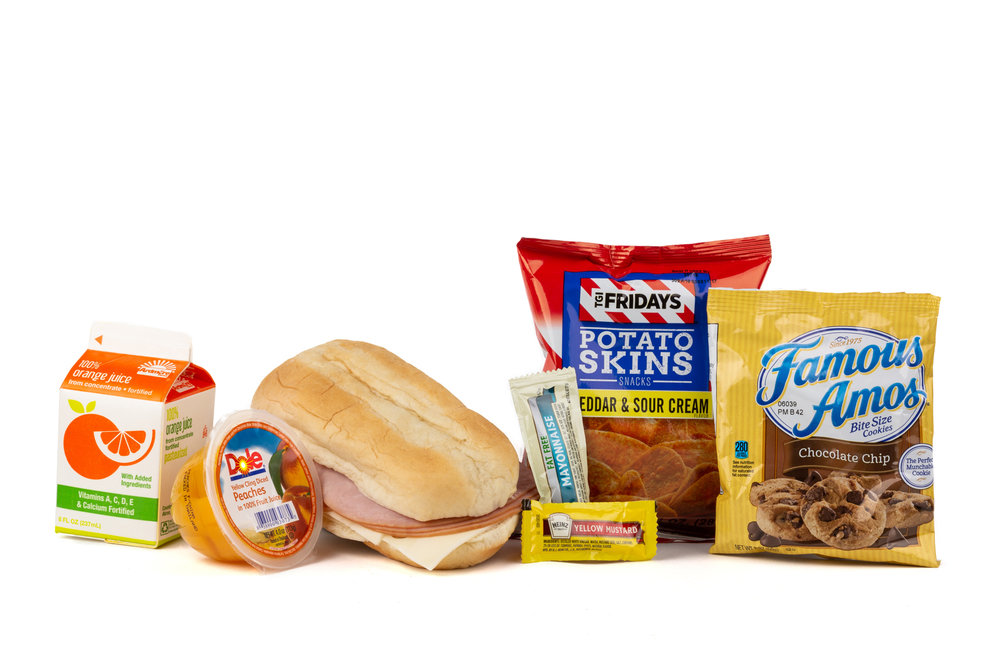 FK06 Ham & Swiss Sandwich - Frozen NAPA 894001E608182  Sandwich - Ham & Swiss on Sub Bun Frozen Chip Potato TGIF Cheddar Sour Cream Diced Peach Cup Cookie Choc Chip Famous Amos Frozen Orange Juice Mayonnaise Packet Fatfree Dressing Mustard Packet Candy Mint Starlight Spearmint