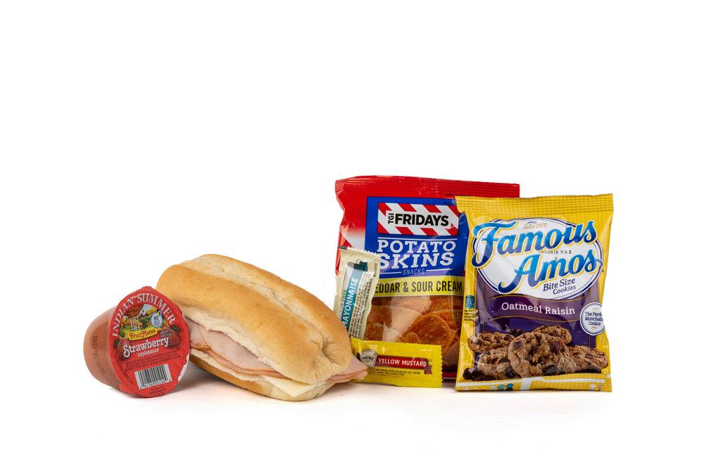 FK04ND - Turk, Ham, Swiss Sandwich - Frozen NO DRINK NAPA 894001E619562  Sandwich - Turkey, Ham, Swiss on Sub Bun Frozen Chip Potato TGIF Cheddar Sour Cream Applesauce Strawberry Cookie Oatmeal Raisin Famous Amos Mayonnaise Packet Fatfree Dressing Mustard Packet Candy Mint Starlight Spearmint