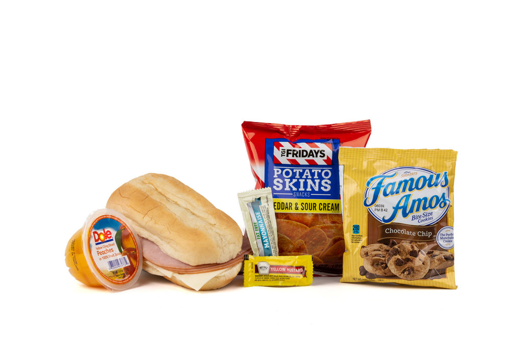 FK06ND Ham & Swiss Sandwich - Frozen NO DRINK NAPA 894001E619560  Sandwich - Ham & Swiss on Sub Bun Frozen Chip Potato TGIF Cheddar Sour Cream Diced Peach Cup Cookie Choc Chip Famous Amos Mayonnaise Packet Fatfree Dressing Mustard Packet Candy Mint Starlight Spearmint