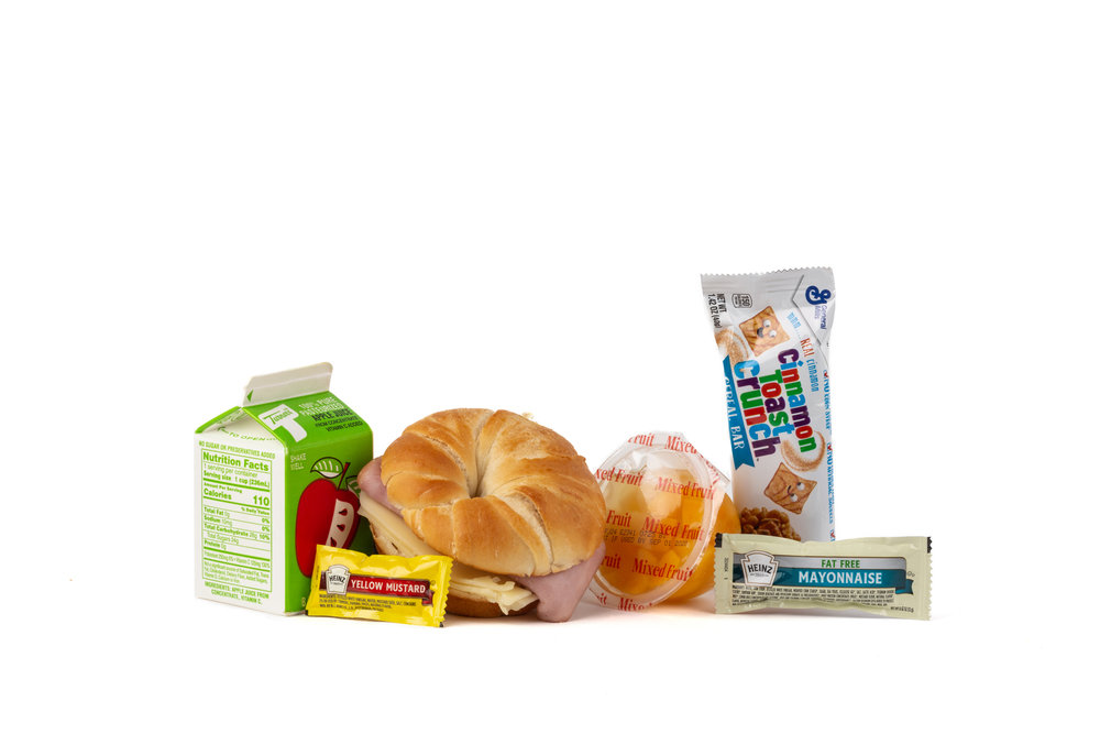 MB03 - Fresh Breakfast Ham/Cheese Croissant  Smoked Ham and Swiss on Croissant Cinnamon Toast Crunch Bar Mixed Fruit Cup Mayonnaise Packet Fat Free Mustard Packet Apple Juice