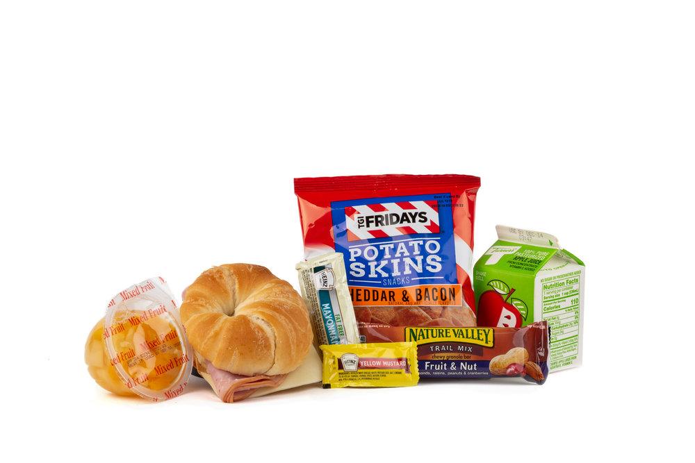 MK06 - Fresh Ham/Swiss/Croissant  Smoked Ham and Swiss on Croissant TGIF Potato Chips Granola Bar Fruit Nut Mustard Packet Mayonnaise Packet Fat Free Mixed Fruit Cup Apple Juice