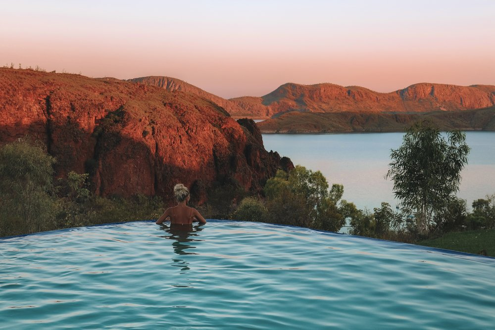 Day 7 / Night 8 - This morning we will walk to the picturesque amphitheatre waterfall of Emma Gorge for a swim and morning tea. Those who don't want to hike can enjoy the shaded poolside cafe area at Emma Gorge Resort. This afternoon we continue on toward Kununurra and then enjoy sunset at Lake Argyle. Overnight: Lake Argyle tourist village