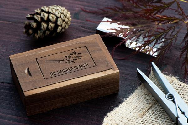 USBs come in a matching wood box, that is personalized for each client.