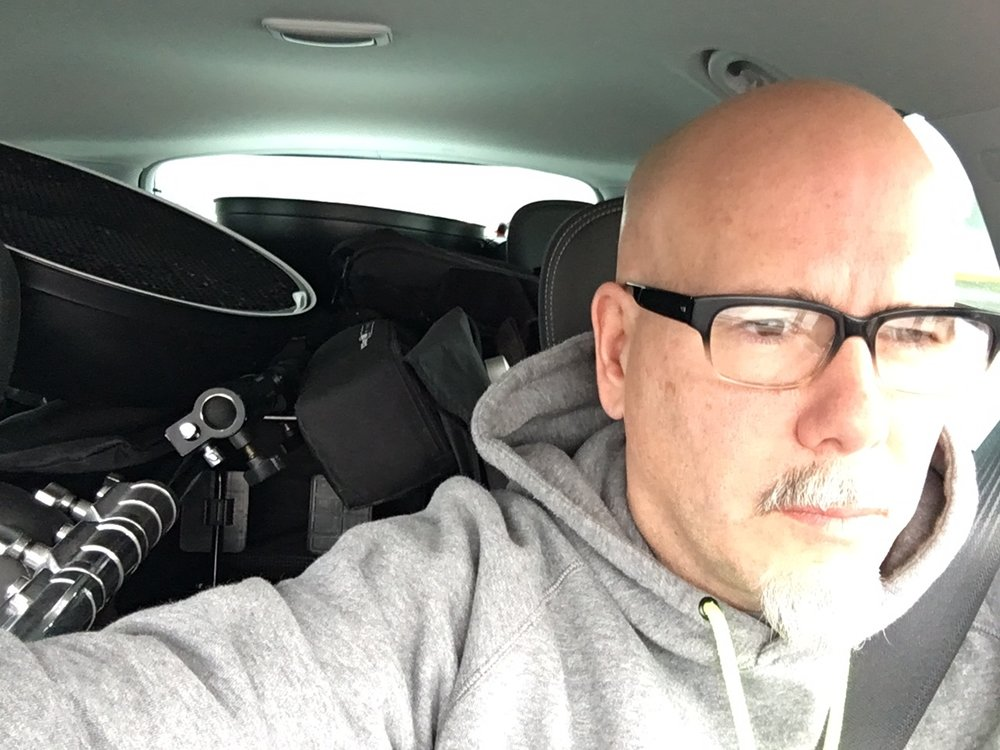 Old fat head with a car full of gear.