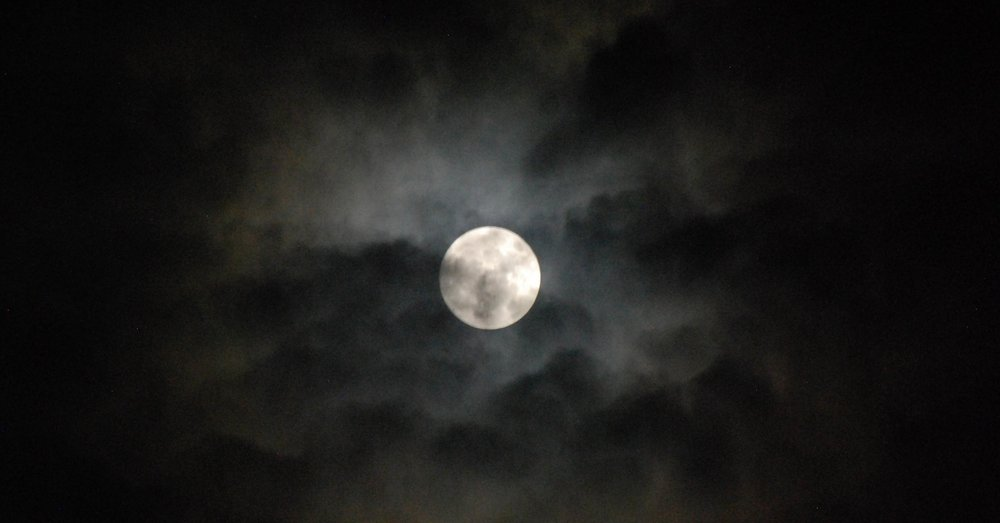 Super Moon through the clouds