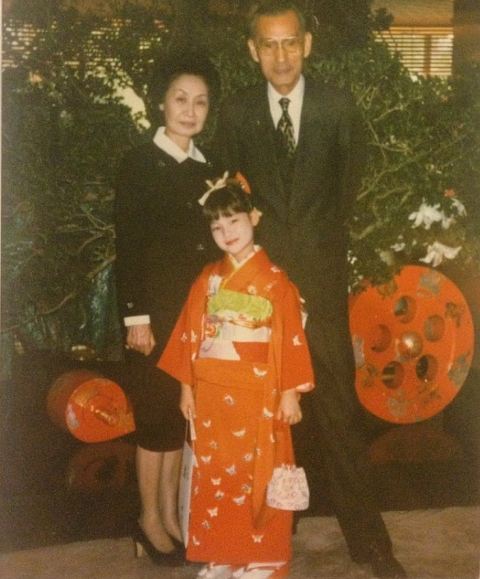 Seven year old me in a kimono during 7-5-3 with my grandpa and grandma.