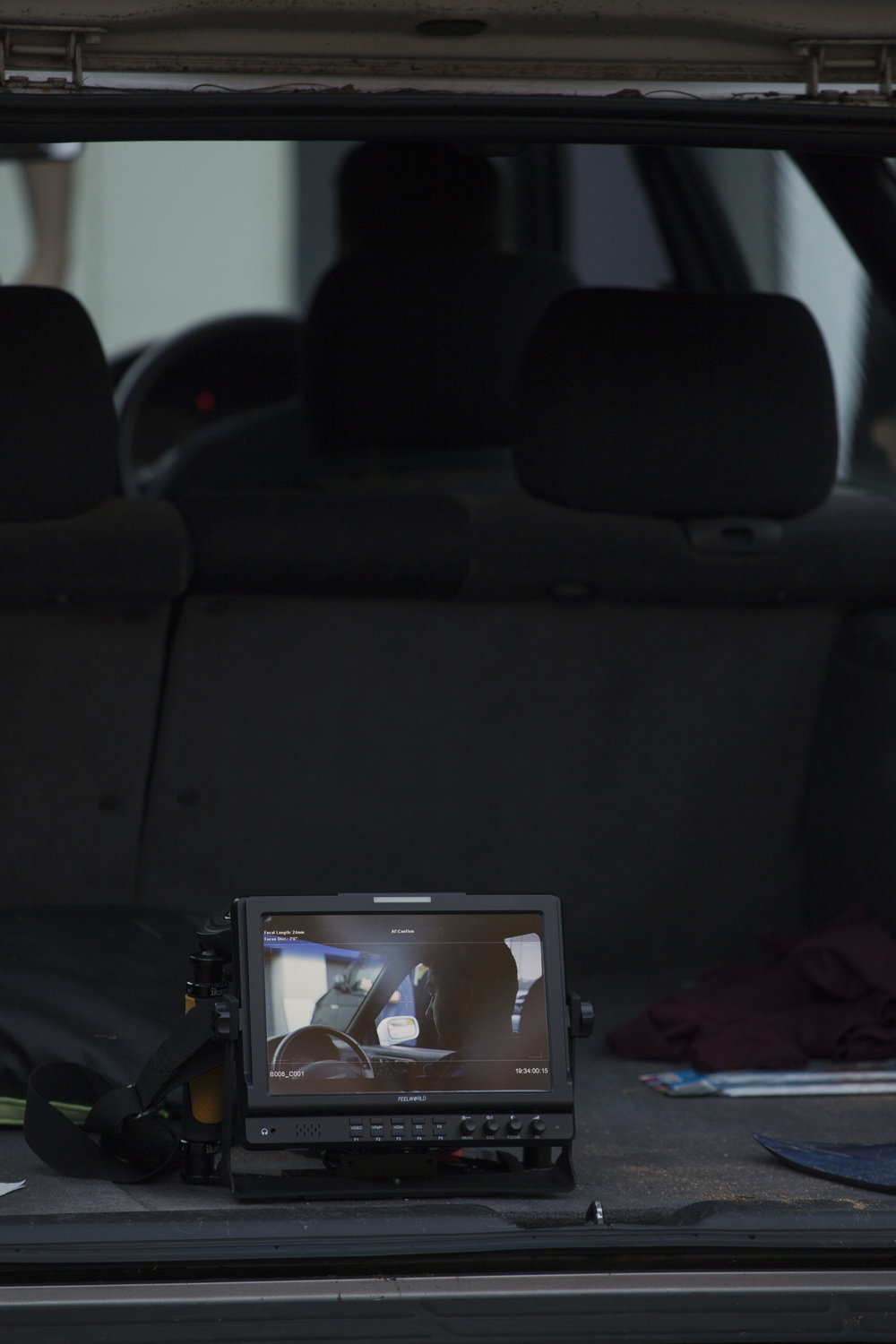 Our director Angus stayed close to the action by keeping his monitor close, allowing crucial decisions to be made during the film process. This picture is in the back of a car where the camera operator is just out of shot to the left.