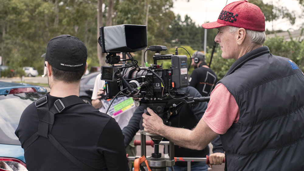 Our DOP (Director Of Photography) Mick Eady prepares to shoot, with his 1st AC Jamin (Assistant Camera Operator). Mick worked closely with our director Angus to ensure they got the same overall look & feel of the film as well as doing what he does best 'Quality Pictures'.