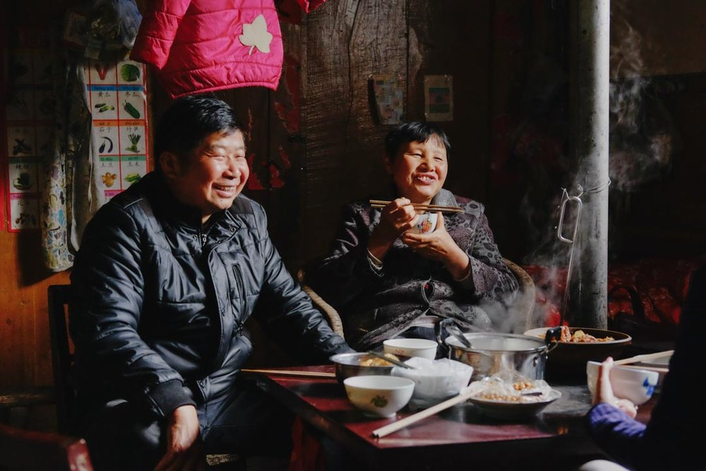 A family I lived with in a village in Guizhou China. The XF35mm is an easy lens in this low-light, relaxed, casual setting.