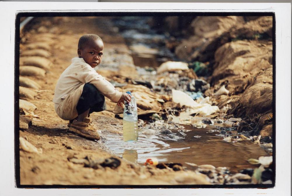boy with dirty water.jpg