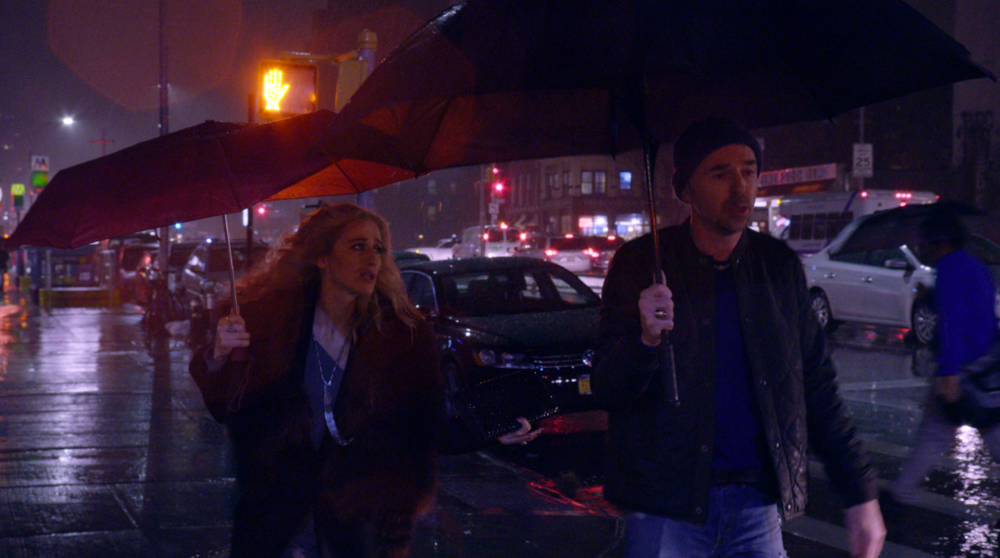 Mia and Grant in the rain 1.png