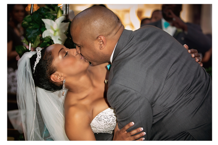 I love this little dip and kiss the groom gave the bride on the way out!