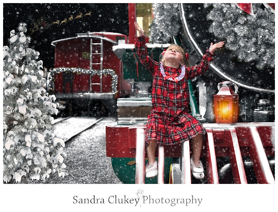 Girl catching snowflakes