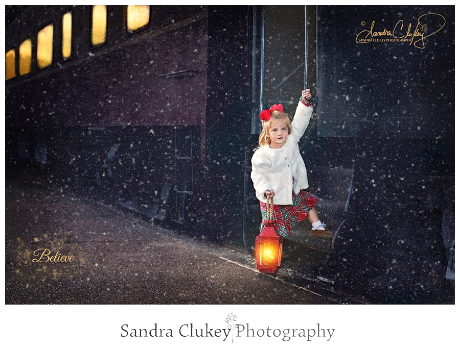 Adorable girl with lantern boards train