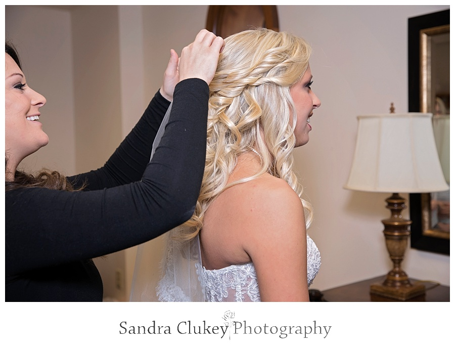 Bride getting hair fixed
