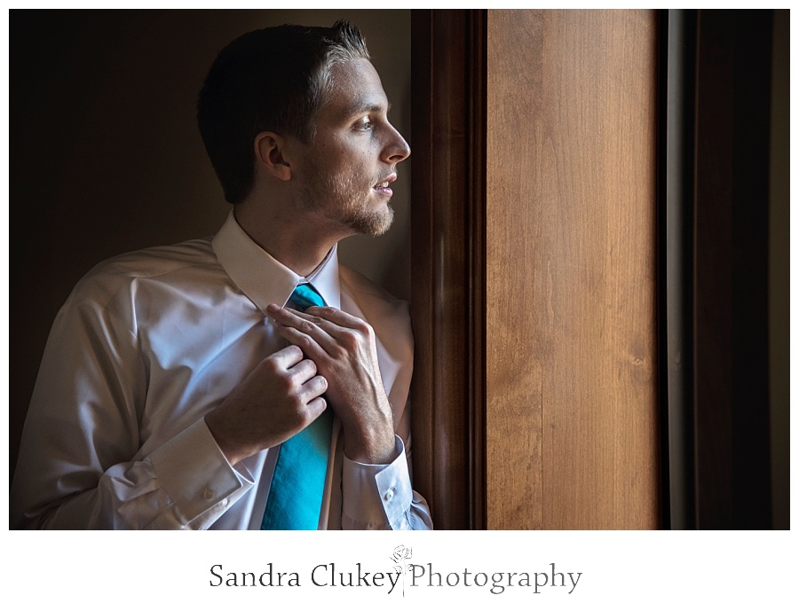 Groom looking out window