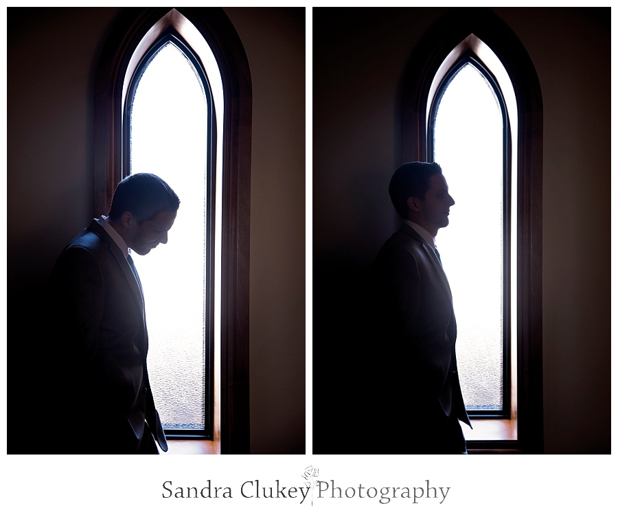 Pensive Groom by church windows