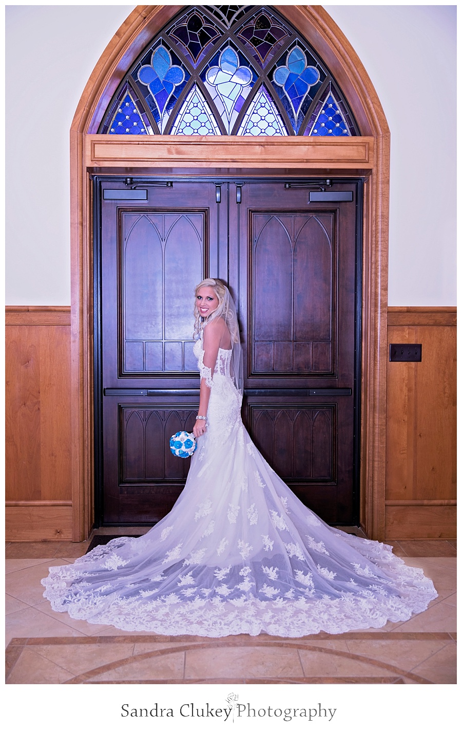 Bride stands at church doors