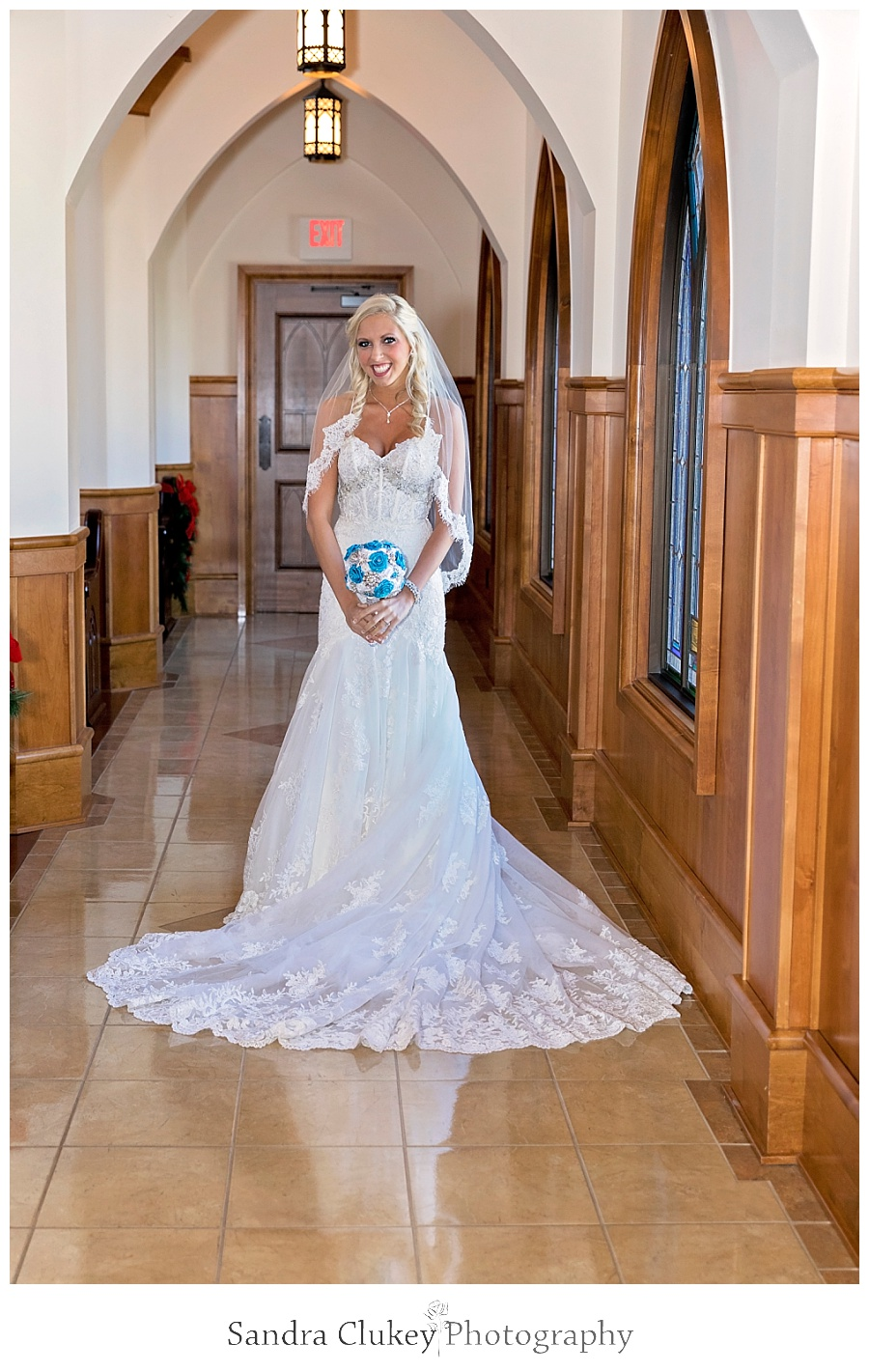 Dazzling bride in church aisle