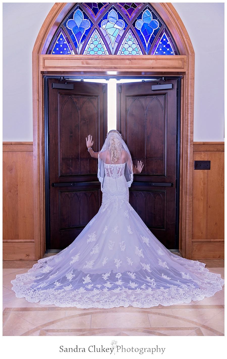 Bride at open church doors