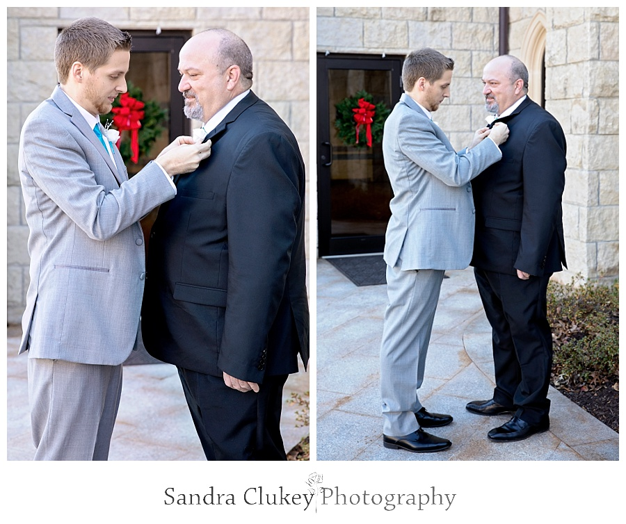 Groom helps Father with boutonniere