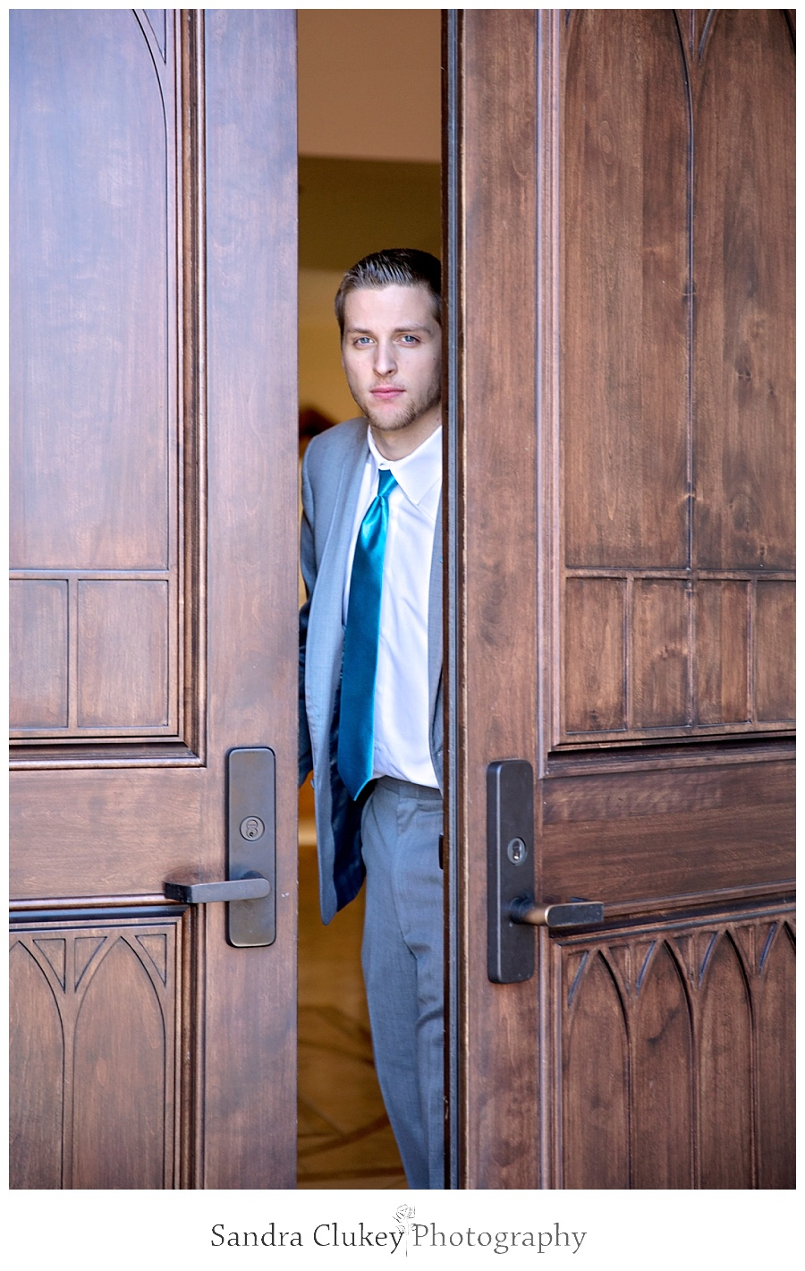 Groom peeking out church doors