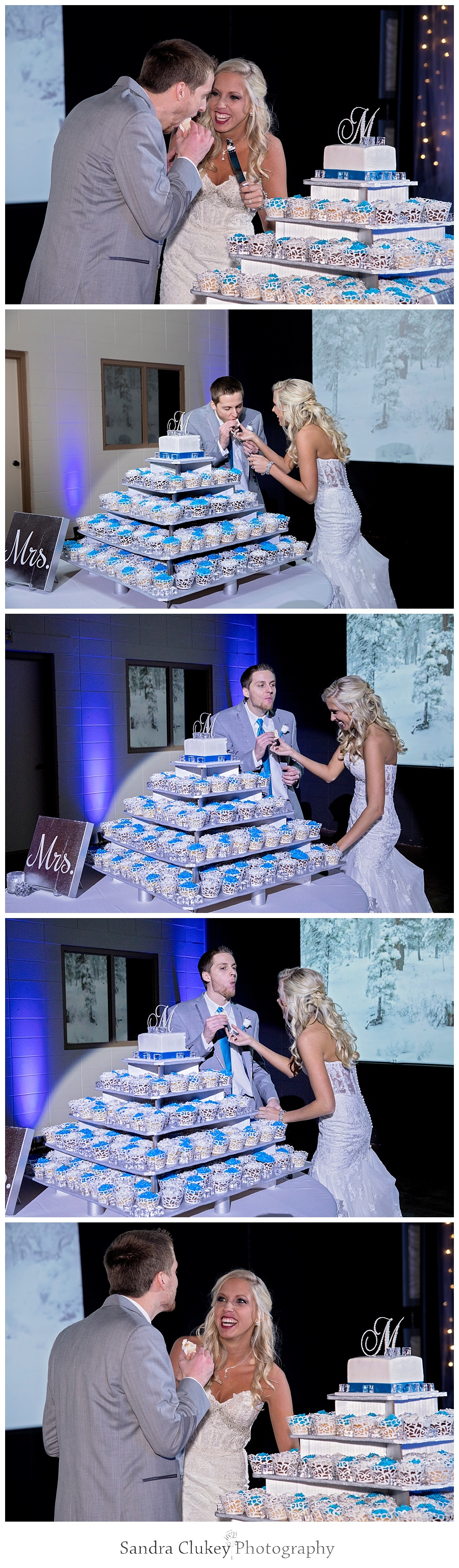 Bride and groom feed each other cake