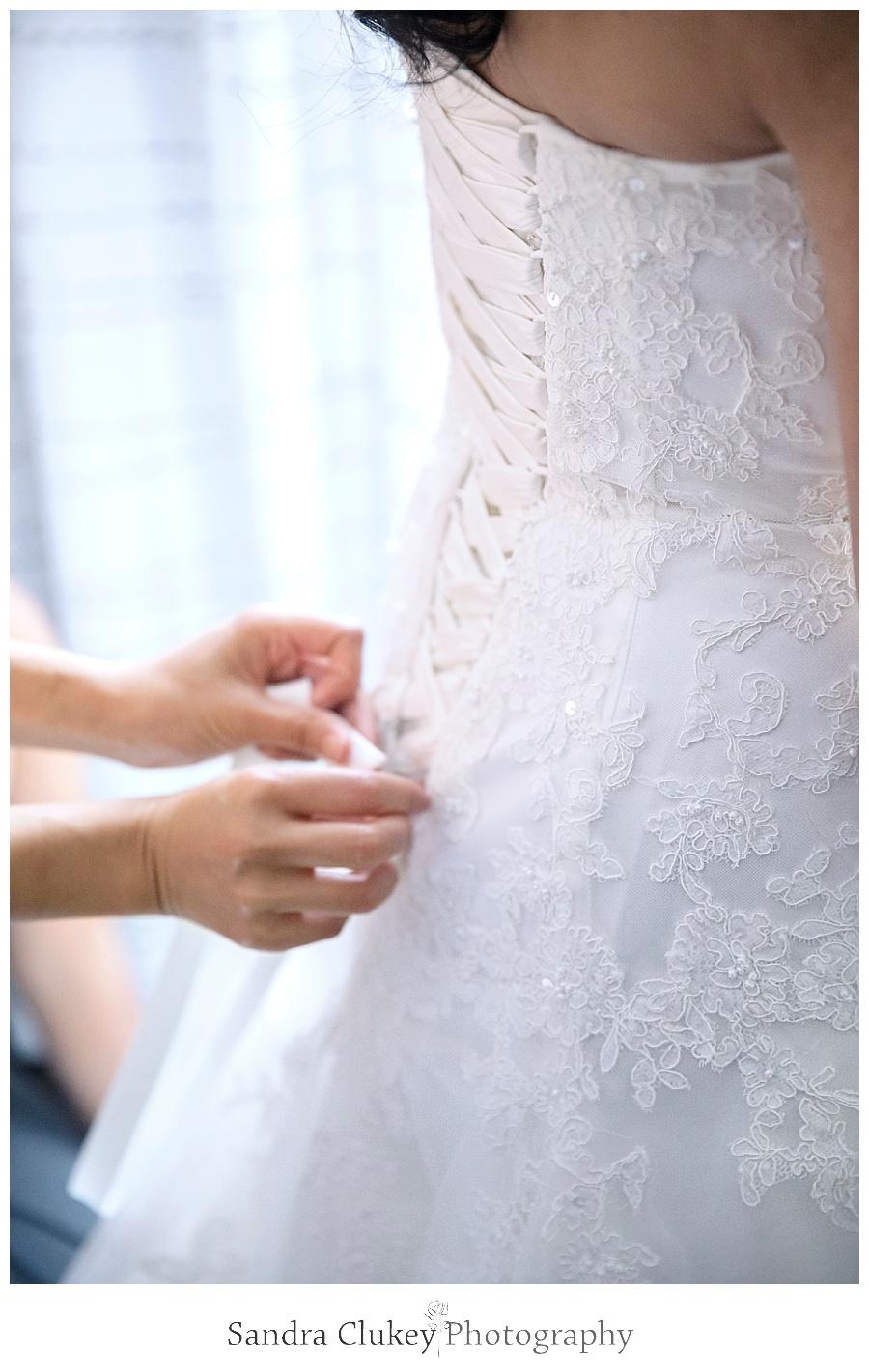Tying brides dress