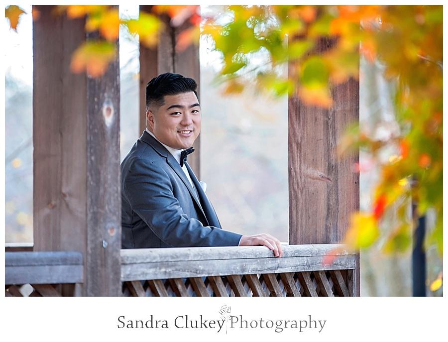 Relaxed groom on bridge