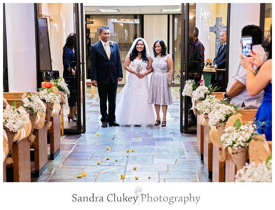 Beautiful Bride begins her walk toward the alter