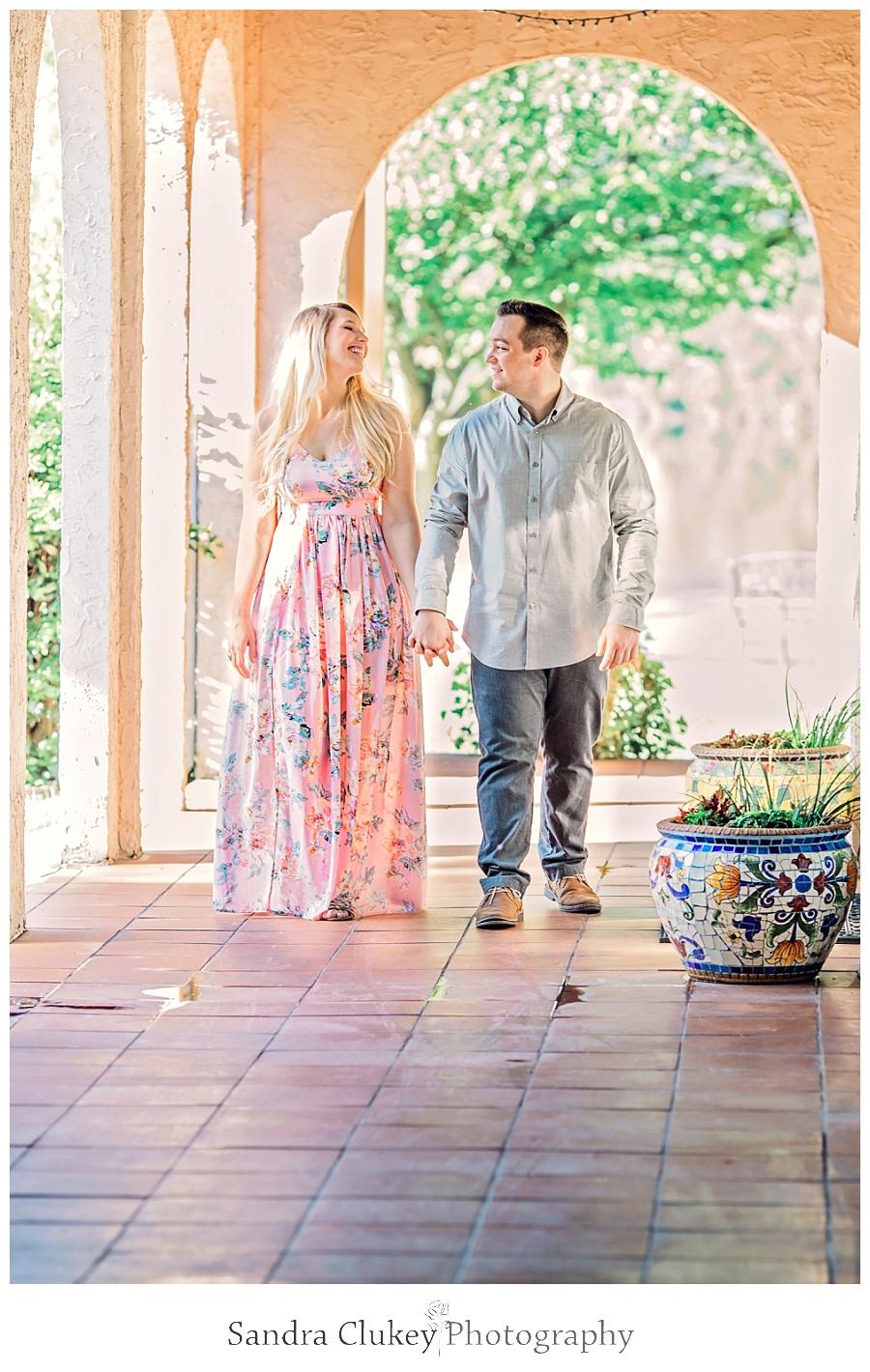 joyful couple strolling hand-in-hand
